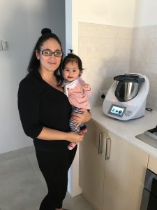 Perth Thermomix consultant holding her baby during a Thermomix delivery demo